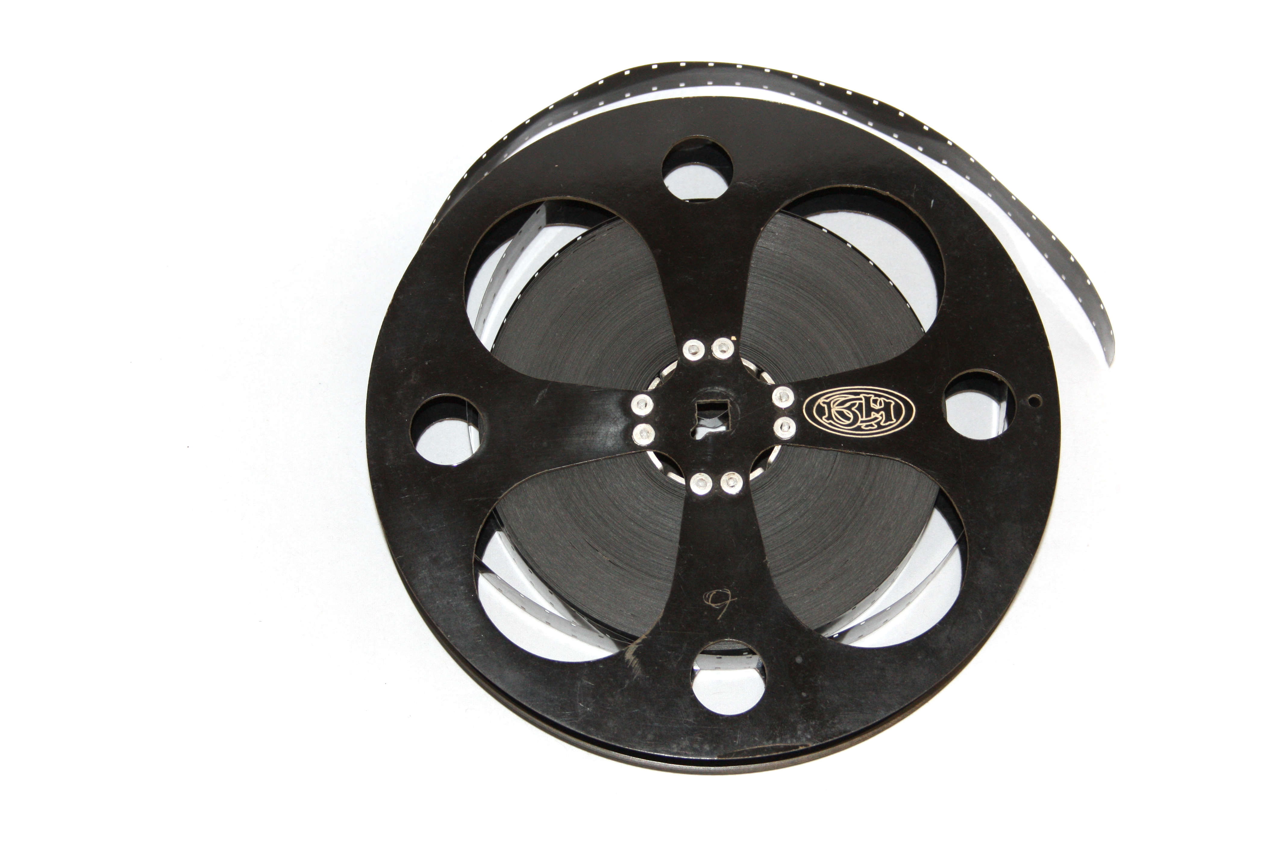 a bakelite reel containing 16mm film