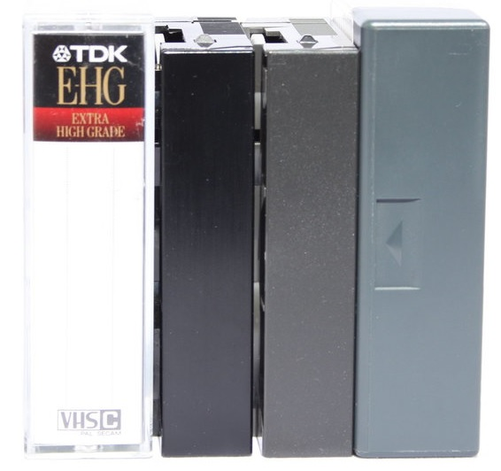 A collection of VHS-C tapes to be transferred to digital